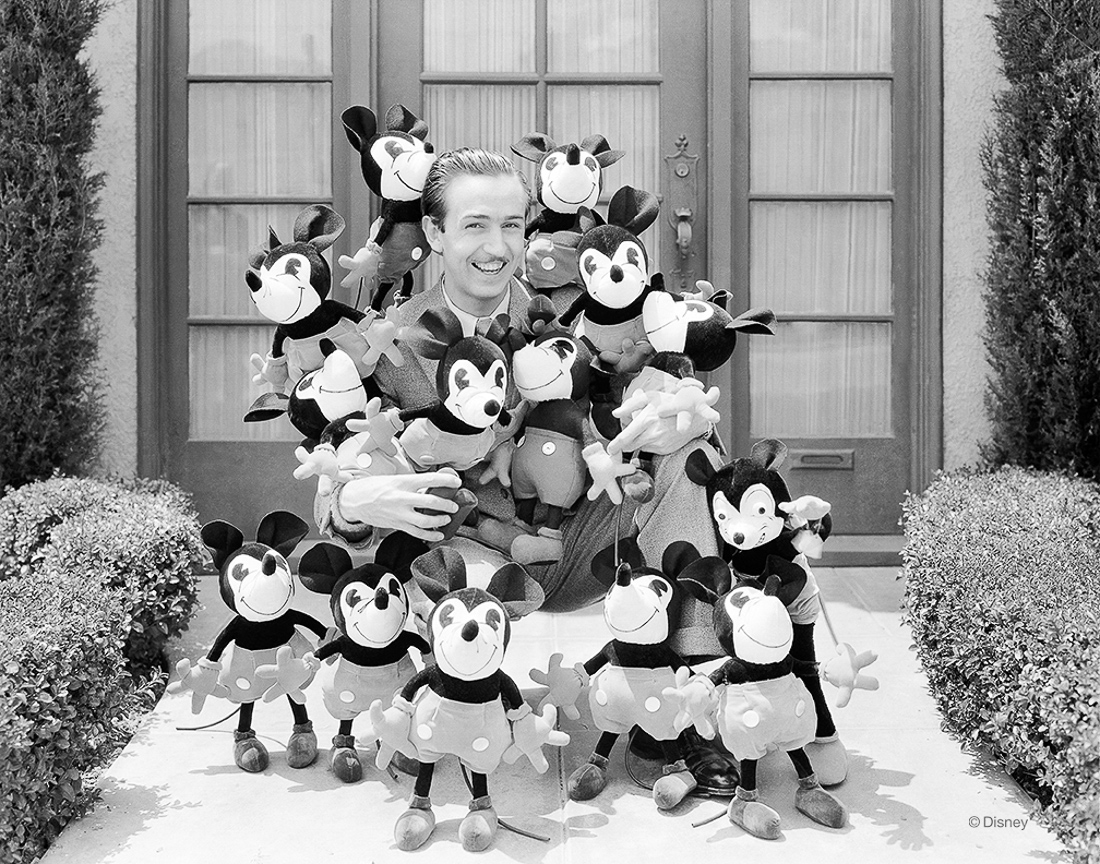 Realizing the great potential that Mickey Mouse could have in the character merchandise business, Walt and Roy Disney accepted an offer from imaginative businesswoman Charlotte Clark to produce the very first Mickey Mouse plush dolls—the original set seen here cuddled up with Walt circa 1932.