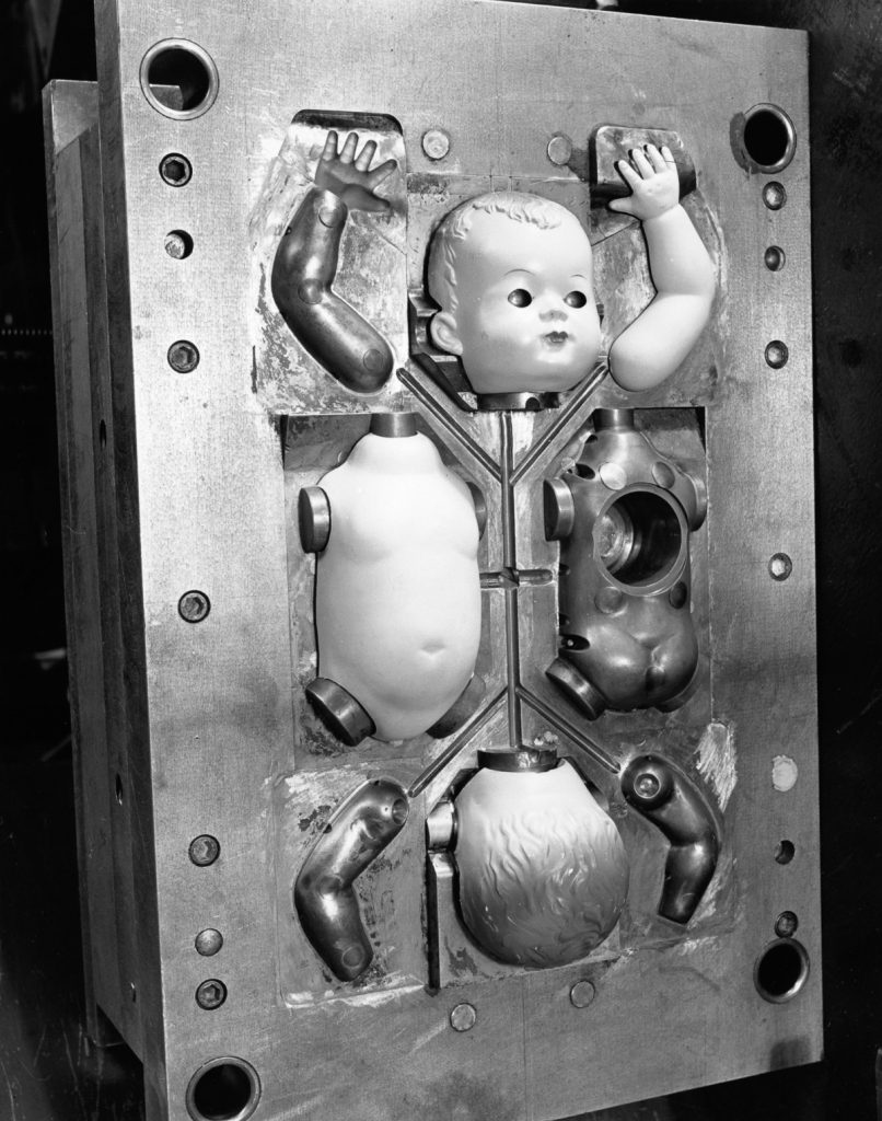 15th December 1951: Parts of a doll in an injection mould at Cascelloid's factory at Leicester. Original Publication: Picture Post - 5617 - Toys Are Big Business - pub. 1951 (Photo by Kurt Hutton/Picture Post/Getty Images)